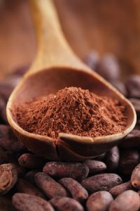 © Lvenks | Dreamstime.com - Cocoa Powder In Spoon On Roasted Cocoa Chocolate Beans Backgrou Photo